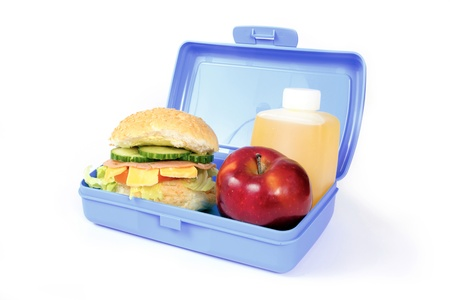 school lunch: Blue lunch box with a hamburger, red apple and orange drink Stock Photo