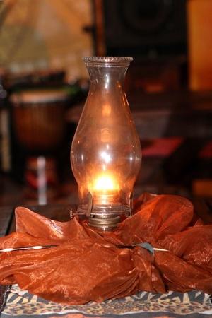 paraffine: Warm glowing paraffin lantern in a restaurant setting