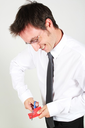 Young man cutting up a credit card photo