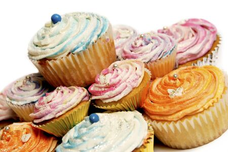 Colorful cupcakes with glitter on a white background Stock Photo - 9607495
