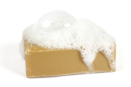 foam: Organic soap with soap suds on top on a white background Stock Photo