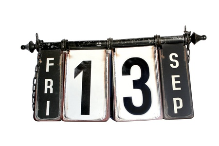 Antique metal signboard on a white background showing the words Friday the 13th Stock Photo - 15937538