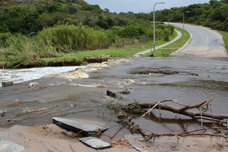FLOODING: Flood disaster showing how water has washed away a road