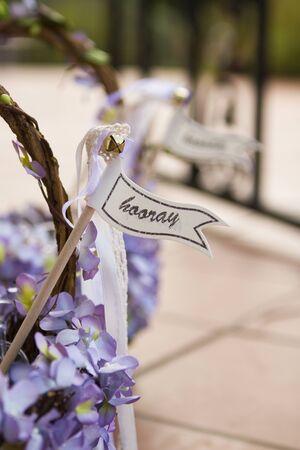 hooray: Hooray sign on a wedding basket with purple flowers