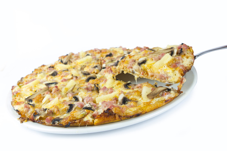 meaty: Meaty pizza with one piece being lifted out of the plate with a metal lifter Stock Photo