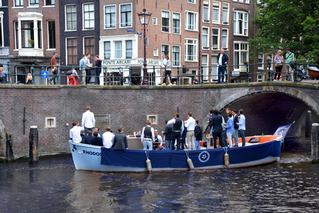 canal houses: The canal houses of Amsterdam, Holland - August 15, 2014: Party boat at the Sail event in Amsterdam, Holland. Editorial