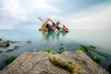 A sunken wreck rusting into the sea