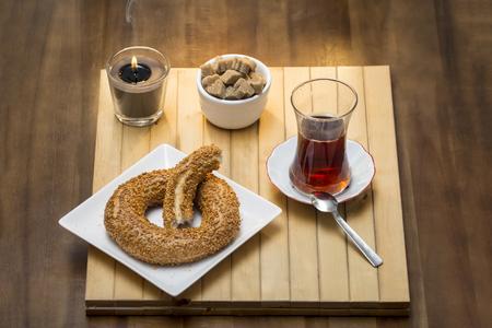 Turkish bagel, simit with Turkish tea on wood table  - Stock Image