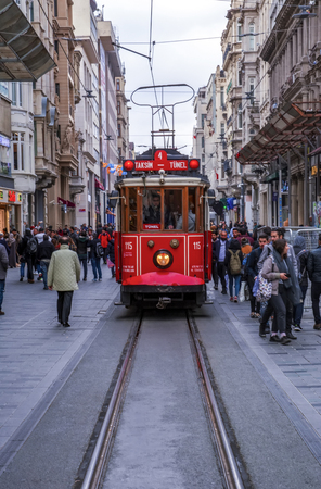 Taksim, Istanbul, Turkey - August 19, 2019: Taksim Istiklal Street is a popular tourist destination and Retro tram moves along a busy Istiklal street in Istanbul.