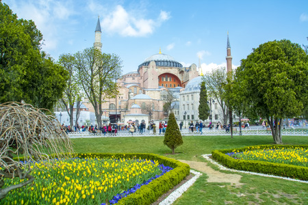 Istanbul Turkey - April 04, 2019: Hagia Sophia is seen behind the tulips and fountain at Sultan Ahmet Square in Istanbul, Turkey Editöryel