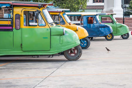 an ally: Tuk tuks lined up in a side ally in Bangkok