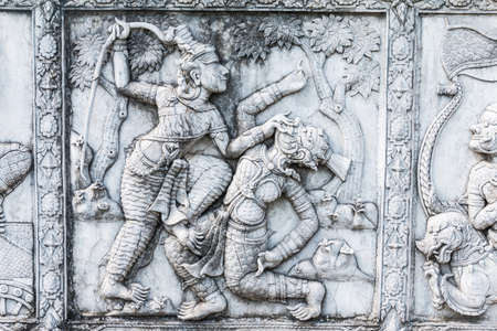 ramayana: masterpiece of traditional Thai style stucco art old about Ramayana story on temple decorative wall at Wat Panan Choeng temple, Ayutthaya, Thailand