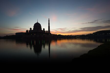 A silhouette of a mosque