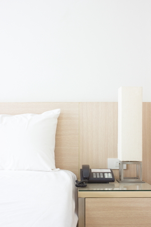 headboard: Headboard of bedroom in five star hotel setting with pillows and lamp Stock Photo
