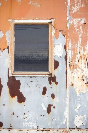 Old Rusty Metal Window of Old Container House 写真素材