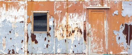 Old Rusty Metal Container House in the abandoned Junkyard, Vintage Style House, Letter Style Composition Background