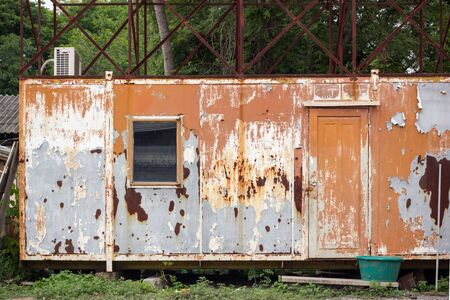Old Rusty Metal Container House in the abandoned Junkyard, Vintage Style House 写真素材