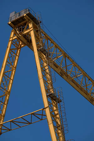 Photo on an industrial theme. Large gantry crane close-up metal trusses