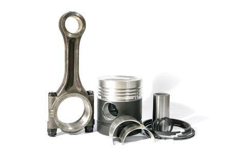 piston rod: photo a set a piston rod the ring piston on a white background
