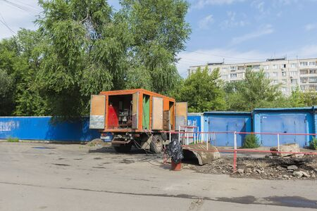 outage power: Russia Krasnoyarsk on July 21, 2015: preparatory work on replacement of a heating main,  the mobile generator for electric welding at installation of heating mains