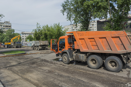 preparatory: Russia Krasnoyarsk on July 21, 2015: preparatory work on replacement of a heating main, preparation for a heating season, loading of soil in the dump truck Editorial