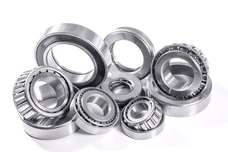 metal parts: it is a lot of different bearings on a white background