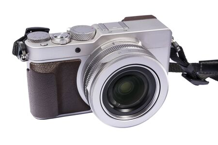 silvery: compact camera of silvery color in retro style with a thong on a white background Stock Photo