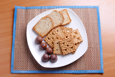 biscuts: Cookies candy crackers on a white plateau a dessert