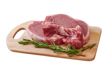 pork stake, pieces of crude meat prepared for preparation with greens on a white background Фото со стока