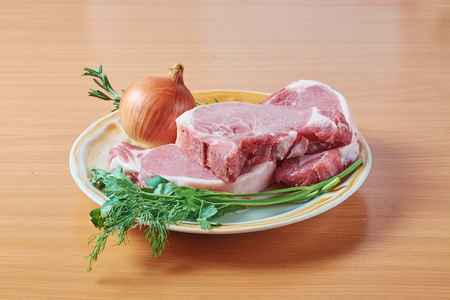 pieces of pork close up on a chopping board before preparation Stock Photo