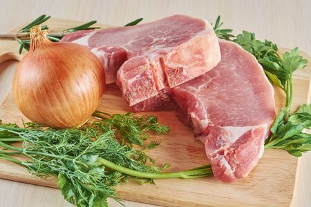 stake: fresh ingredients for preparation of a stake on a chopping board Stock Photo