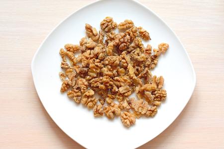 walnut seeds on a white plate close up