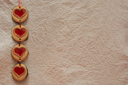 the background image cookies hearts against the background of crumpled paper by Valentine's Day