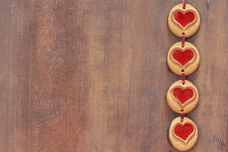 cookies hearts on a wooden background laid out by a chain by St. Valentine's Day