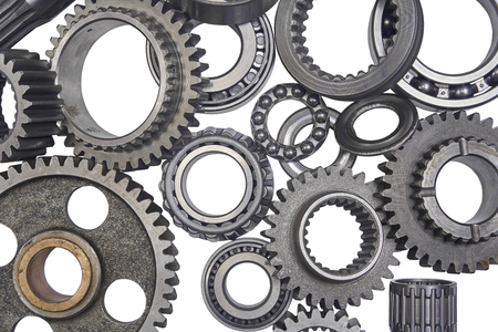 the background image is a lot of gears and bearings isolated Stockfoto