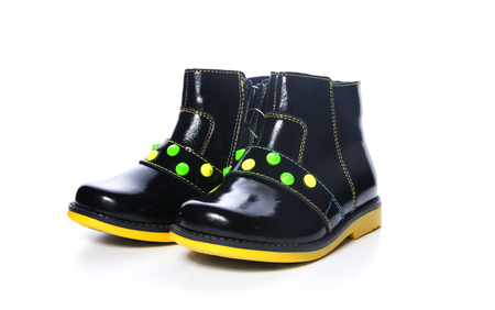 children's boots of black color on a white background