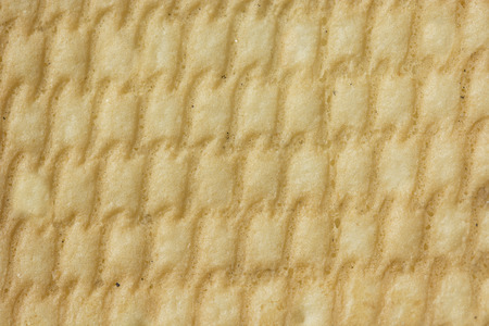 background, reverse side of cookies, yellow color, texture baked dough