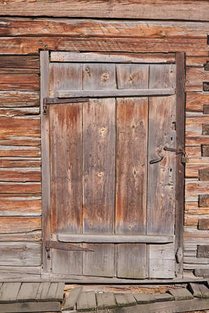 old wooden door to the ancient house Stock Photo
