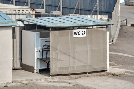shoddy construction of a street toilet near the building site