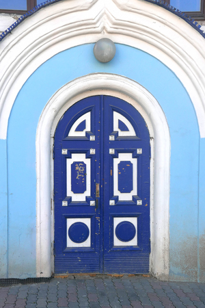 vintage wooden door of blue color entrance to the old building