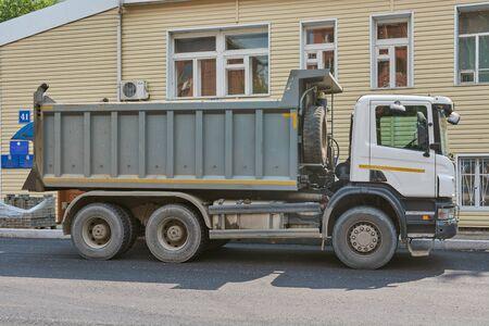 Krasnoyarsk, Russia - July 26, 2018: SCANIA truck delivered stones for laying of sidewalks, Lenina street.