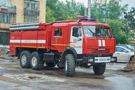 Krasnoyarsk, Russia - July 28, 2018: KAMAZ-43118 fire truck preparation to patrol of an action. Frontal look.