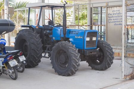 Pattaya, Thailand - May 16, 2018:  tractor LANDINI 8860 used on the beach for descent to water of small size vessels and scooters