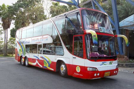 Pattaya, Thailand - May 16, 2018: The excursion bus Hino, expects group of tourists in the territory of hotel.