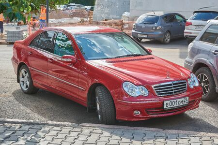 Krasnoyarsk, Russia - August 15, 2018: Mercedes Benz C 320 car is parked at new bank branch. Front right view.