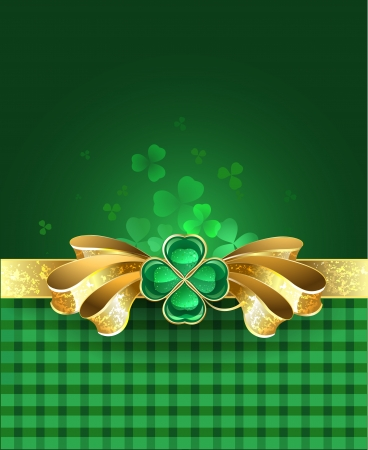 golden bow with a brooch in the form of a clover with four leaves on a green plaid background