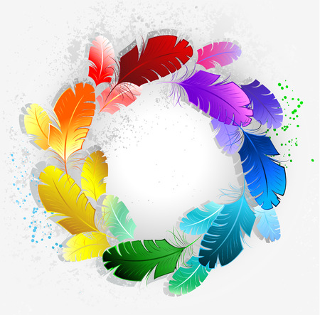 circle of bright rainbow feathers on a light background