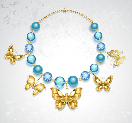 bead embroidery: necklace of gold butterflies and blue beads of different textures on a light textural background