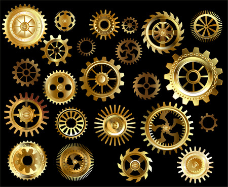 Set of gold and brass gears on a black background.