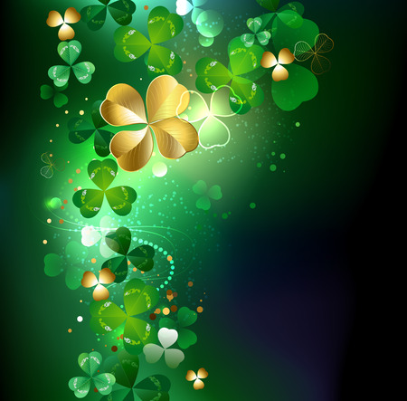 fortunate: gold clover with four leaves on a dark glowing background.